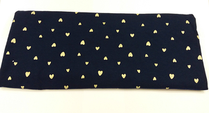 Gold hearts on dark navy blue